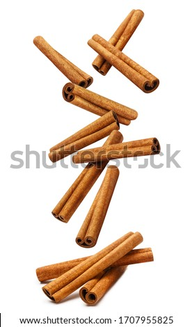 Falling delicious cinnamon sticks, isolated on white background Foto stock ©