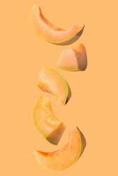 Falling fresh melon isolated on colored background