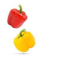 Falling fresh whole red,yellow bell pepper isolated on white background. with copy space