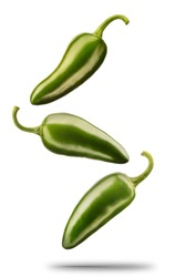 Falling green chili or chilli pepper isolated on white background with clipping path