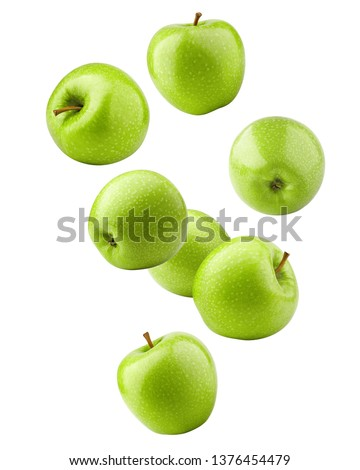 Falling green juicy apple isolated on white background, clipping path, full depth of field