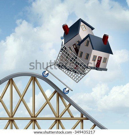 Falling home prices and declining real estate value financial concept as sold houses in a shopping cart going down a roller coaster as a business financial concept.