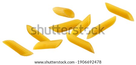 Falling italian penne rigate pasta isolated on white background with clipping path ストックフォト ©
