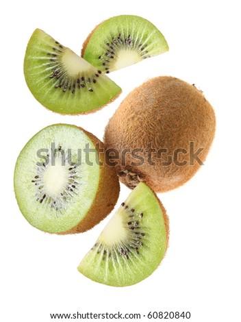 Falling kiwi fruit and kiwi slices. Isolated on a white background.
