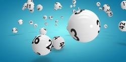 Falling lottery balls  against blue vignette background