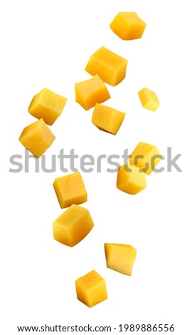 falling mango chunks  isolated on a white background with a clipping path. piece of mango in the air.
