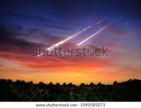 Stock Photo Falling meteorite, asteroid, comet on Earth. Elements of this image furnished by NASA.