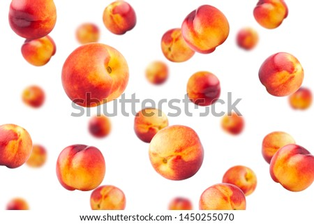 Falling Nectarine or peach isolated on white background, selective focus
