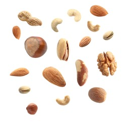 Falling nuts on white background