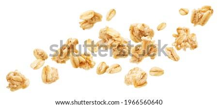 Falling oat granola, crunchy muesli isolated on white background Foto stock ©