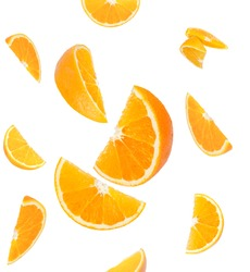Falling orange and orange slices. Isolated on a white background.