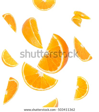 Shutterstock Falling orange and orange slices. Isolated on a white background.