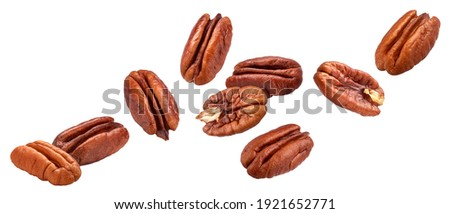 Falling pecan nuts isolated on white background with clipping path Foto stock ©