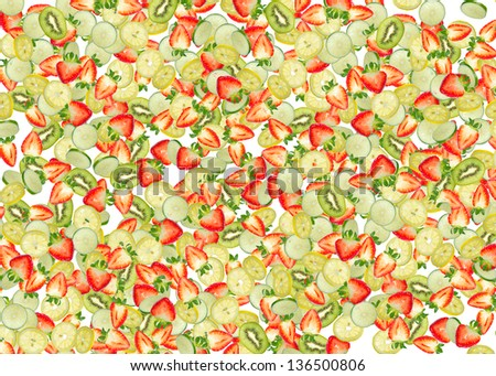 Falling pieces of assorted fruits isolated on white background.
