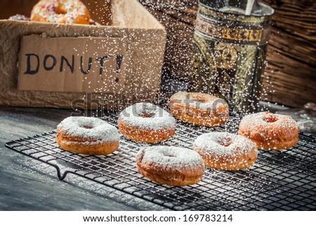 Falling powder sugar on donuts