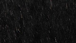 Falling raindrops footage animation in slow motion on black background, black and white luminance matte, rain animation with start and end, perfect for film, digital composition, projection mapping