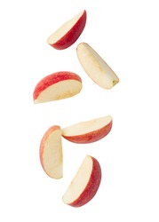 Falling red apple slice isolated on white background with clipping path.