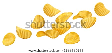 Falling ridged potato chips isolated on white background with clipping path Stock photo ©