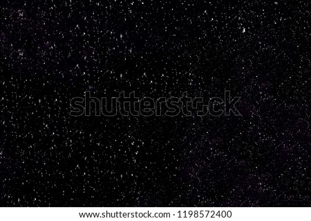 Falling snow on a black background