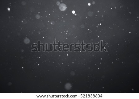 Falling snow on black background. #521838604