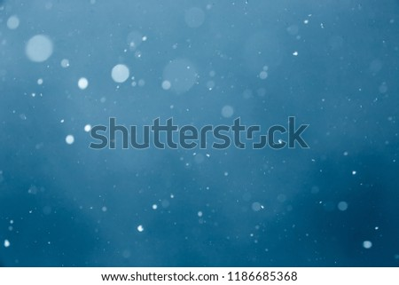 Falling Snow On The Blue Background #1186685368