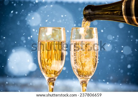 Falling Snow with Two Champagne Glasses On The Blue Background #237806659