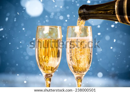 Falling Snow with Two Champagne Glasses On The Blue Background #238000501
