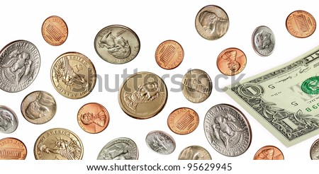Falling US coins and currency on a white background.