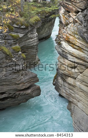 "Falls ""Athabasca"" in a deep canyon in the north of Canada"