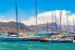 False Bay coast landscape with yachts boats jetty Long Beach and mountains in Simons Town Cape Town Western Cape South Africa.