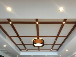 false ceiling decorated with wood and lamp