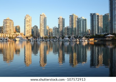 False Creek, Reflections, Condos, Marina, Vancouver. Early morning view of a False Creek marina and Yaletown condominiums in downtown Vancouver. British Columbia, Canada.