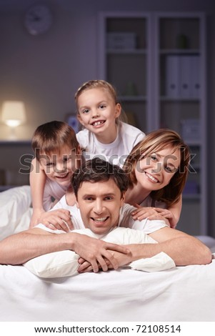 Families in bed at night at home