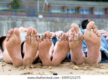 Families sandy feet on beach #1009121275
