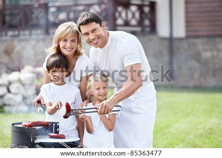 Families with children at barbecue