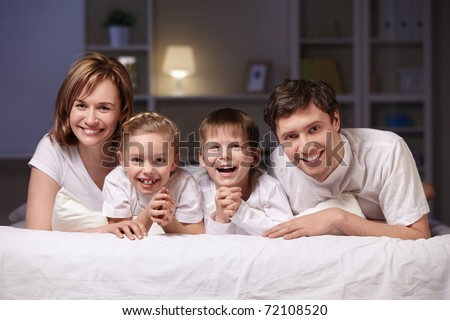 Families with children in bed at night