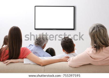 Family and blank TV display at home