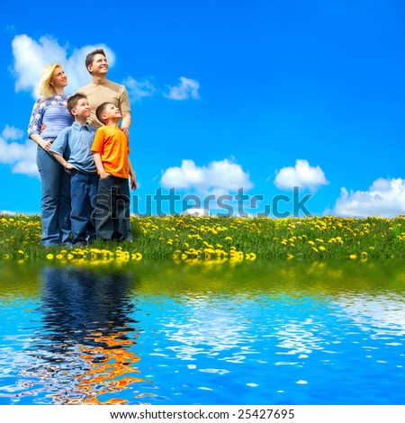 Family and blue sky. Father, mother and sons near the lake