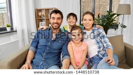 family and people concept - portrait of happy father, mother, little son and daughter at home