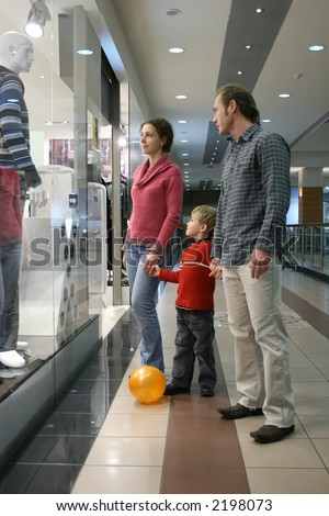 family and shop window