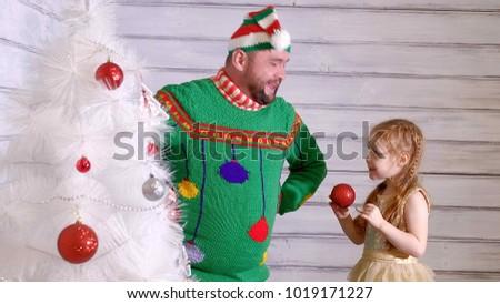 Stock Photo Family around a Christmas tree to decorate it 4k