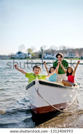 Family at beach with row boat. #1312406993