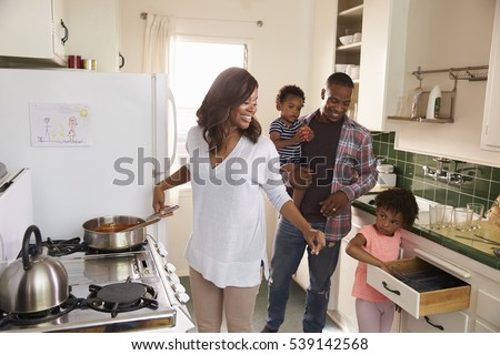 family at home preparing meal...