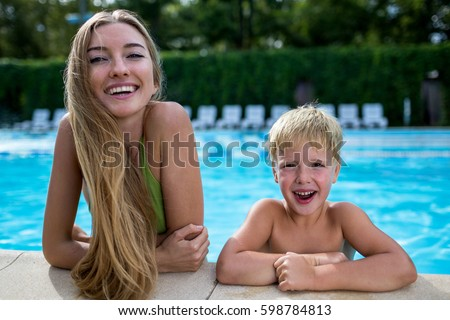 Free Photos Two Cute Little Girls In Swimming Pool Posing