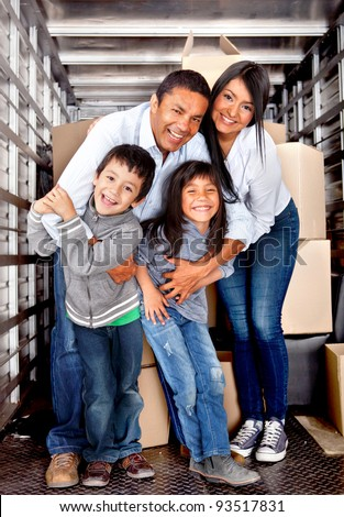 Family at the back of a moving truck ready to go to their new house