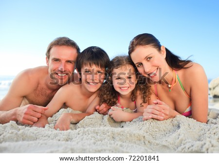 Family at the beach - stock photo