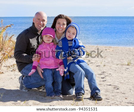 Family at the beach portrait during the winter