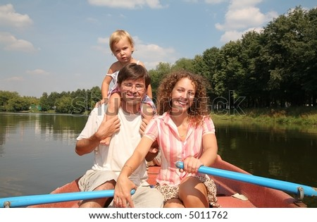 family at the lake in the boat 2