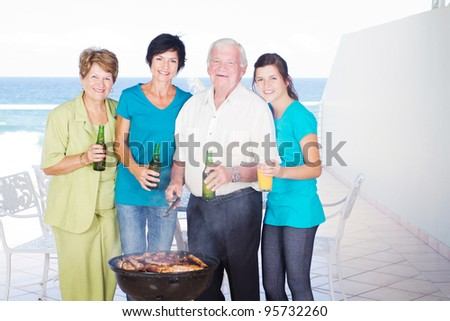 family barbecue on balcony with sea view background