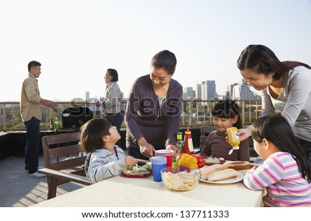 Family barbeque party - stock photo